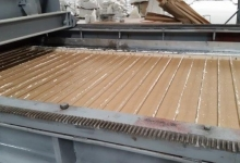 the mould the slab is poured into, the wires allow the material to sit u....jpg