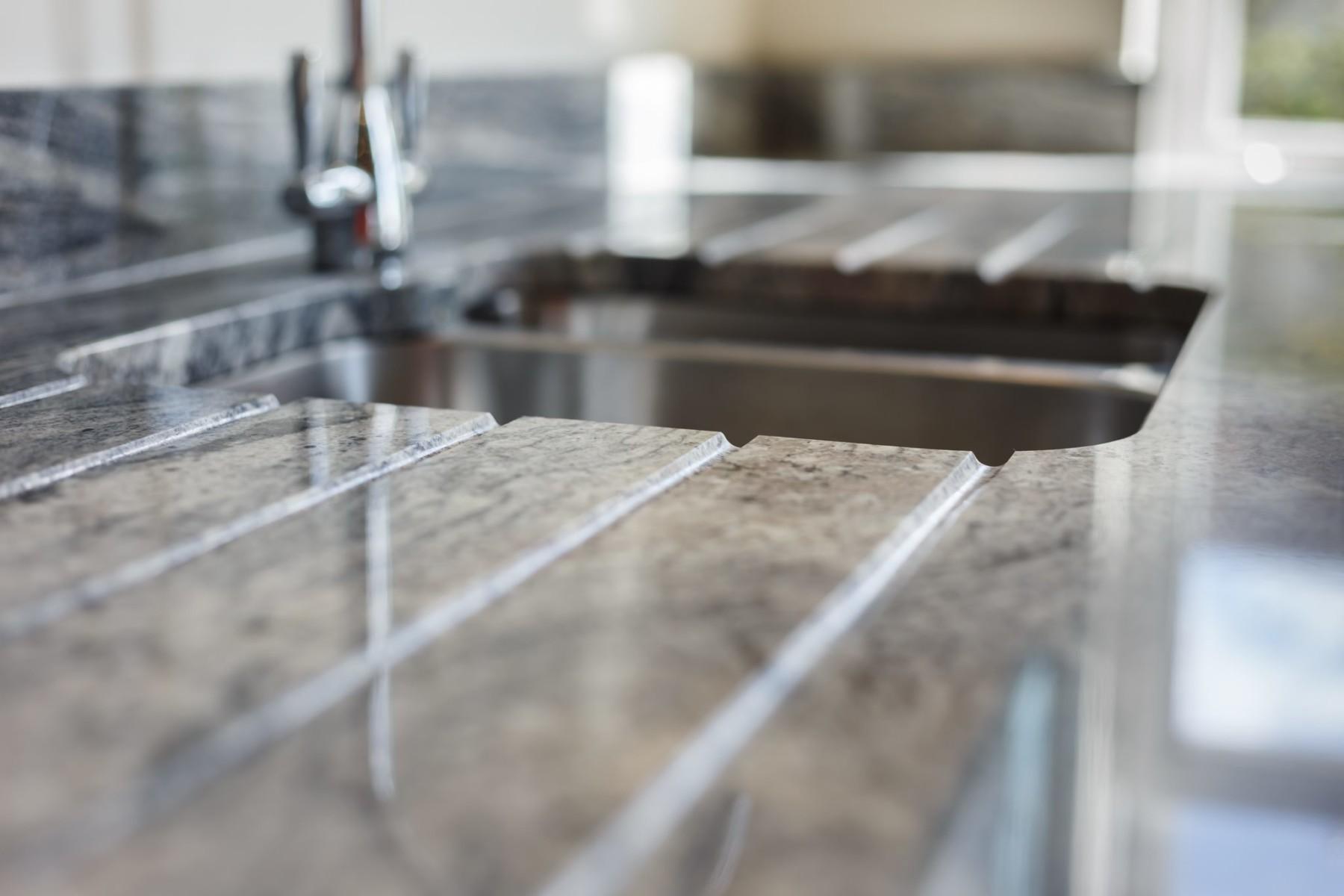 kinawa white granite bh kitchens 1