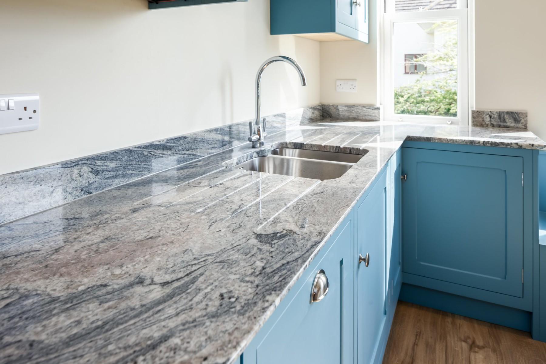 kinawa white granite bh kitchens 2